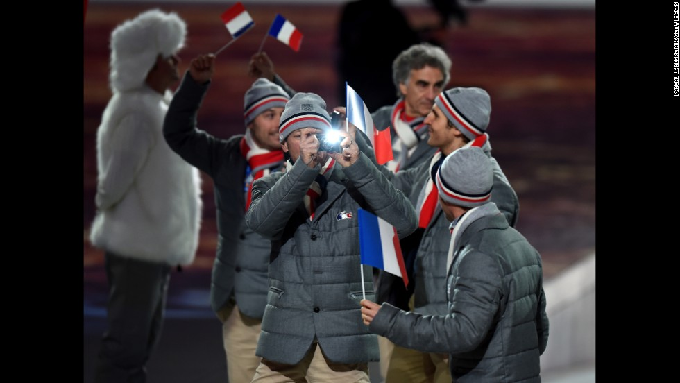 French Olympians take pictures.
