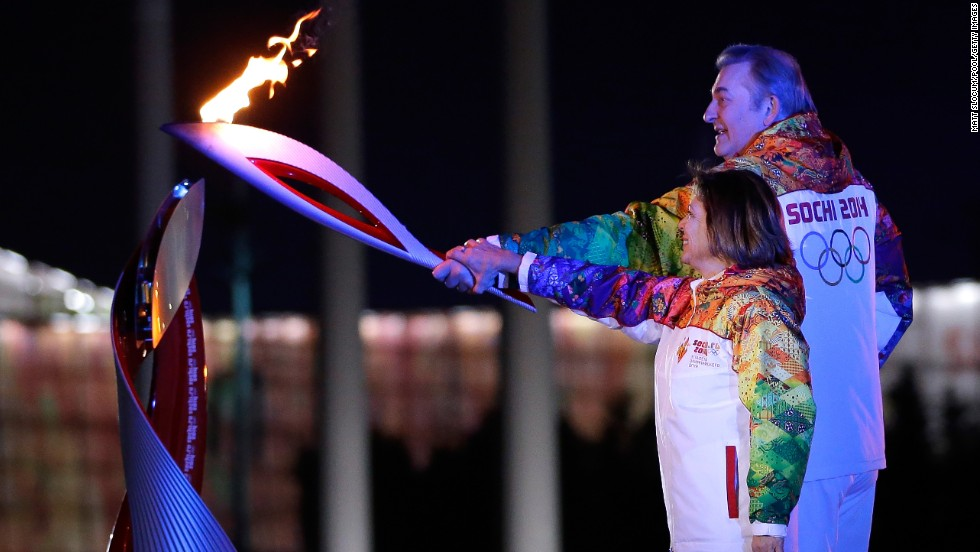 Two of Russia's greatest athletes, Irina Rodnina and Vladislav Tretiak, light the Olympic cauldron. Rodnina was a three-time gold medalist in figure skating. Tretiak won three golds as goalie of the Soviet hockey team.