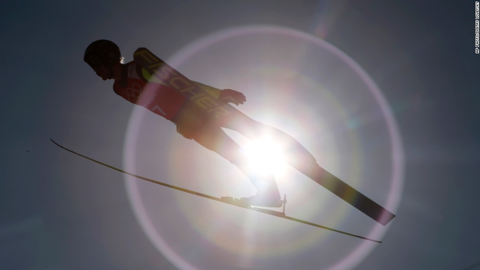 "FEBRUARY 7 - KRASNAYA POLYANA, RUSSIA: Czech Republic's Roman Koudelka trains for the men's ski jump at the 2014 Winter Olympics. <a href=""http://cnn.com/2014/02/07/world/europe/russia-sochi-winter-olympics/index.html?hpt=hp_t2"">Russia kicks off the opening ceremony Friday </a>in Sochi as the world turns its attention to the costliest Olympic Games in history."