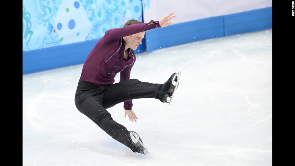 Jeremy Abbott of the United States falls as he performs in the team figure skating event.