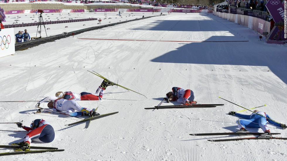 Norway's Marit Bjoergen, Sweden's Charlotte Kalla, Norway's Therese Johaug, Norway's Heidi Weng and Finland's Aino-Kaisa Saarinen fall to the ground after the women's skiathlon on February 8.