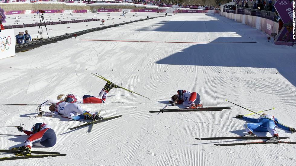 Norway's Marit Bjoergen, Sweden's Charlotte Kalla, Norway's Therese Johaug, Norway's Heidi Weng and Finland's Aino-Kaisa Saarinen fall to the ground after the women's skiathlon on February 8.
