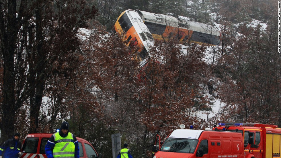 Rescue workers work the scene of a train accident near Digne-les-Bains in the French Alps after a train derailed on February 8. The train collided with a large boulder, leaving two people dead and several others injured.