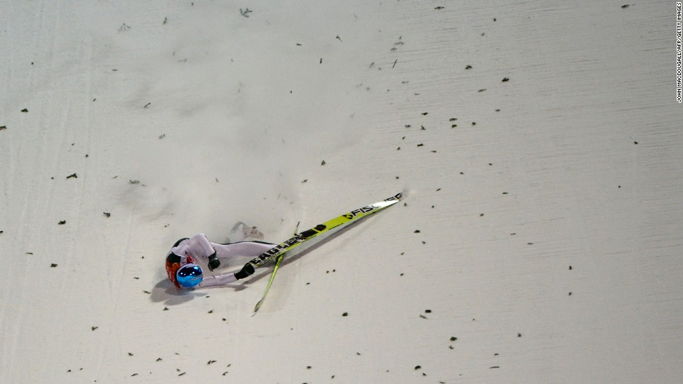 Slovenia's Robert Kranjec falls while competing in the men's normal hill ski jumping event.