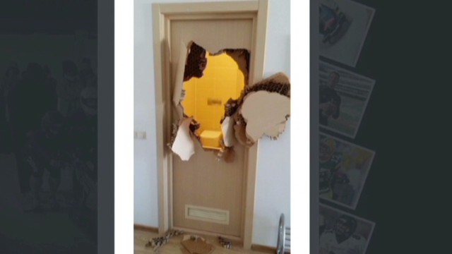 Bobsledder busts through bathroom door