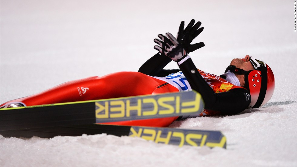 Simon Ammann of Switzerland reacts after landing his final jump in the men's normal hill ski jumping event February 9.