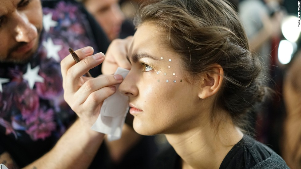 Gemstones are applied to a model's eyes before the Lela Rose show on February 9.