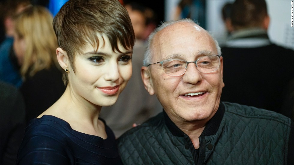 Max Azria, who designs the Herve Leger collections, poses with actress Sami Gayle backstage before his show.