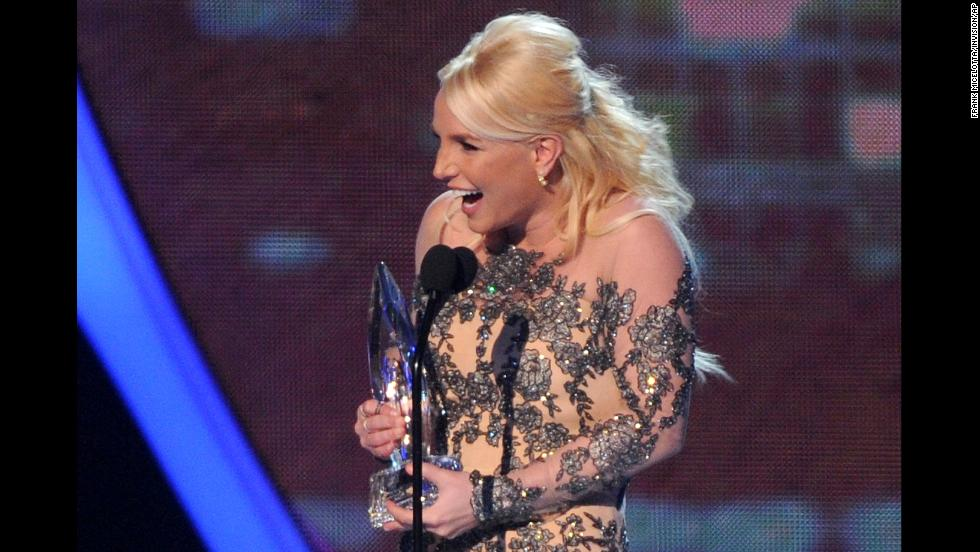 Spears takes the stage at the 2014 People's Choice Awards to accept the favorite pop artist award.