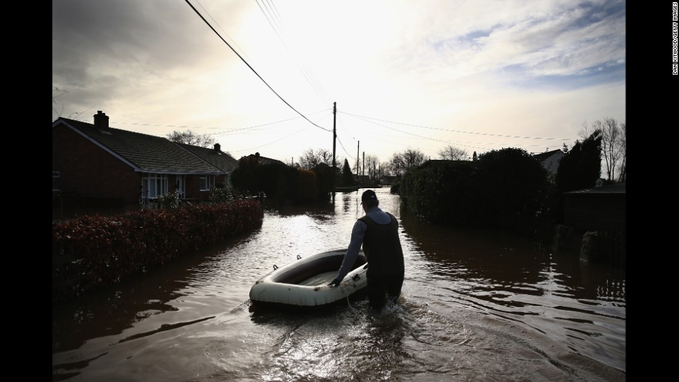 A man wades through floodwaters in Moorland on February 9.