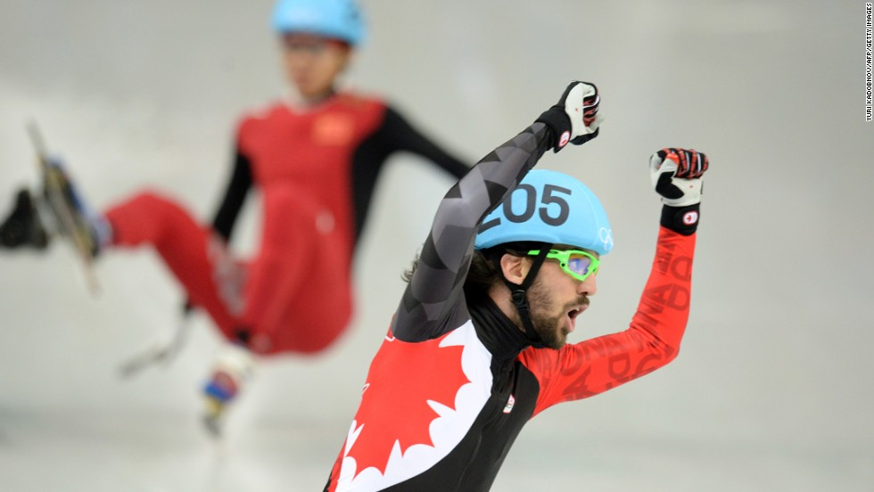 Canada's Charles Hamelin celebrates after winning the 1,500-meter final on February 10.