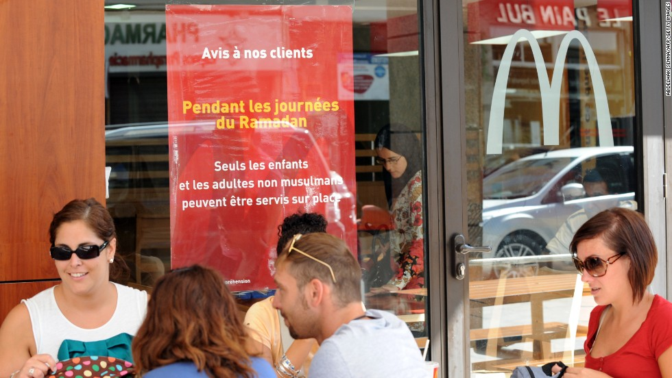 Non-Muslims eat lunch on the terrace of a McDonald's in Rabat, Morocco. Muslim adults are forbidden from being served at the restaurant during the day during fasting for the holy month of Ramadan.