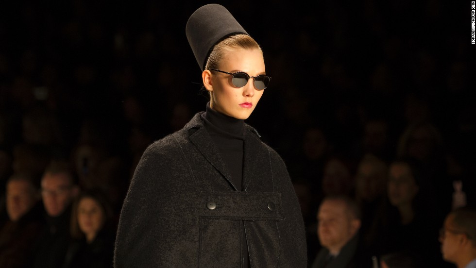 Karlie Kloss wore a fez down the runway for Carolina Herrera.