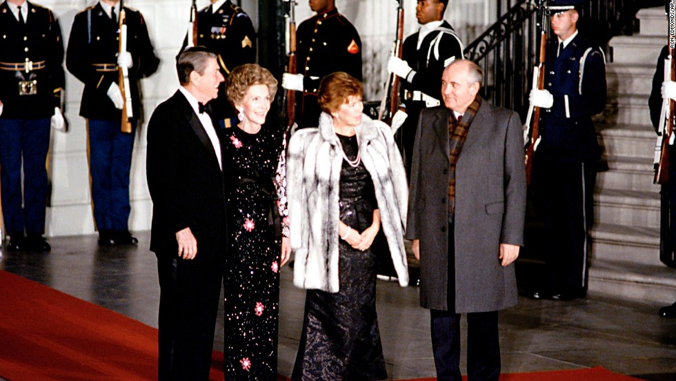 President Ronald Reagan and first lady Nancy Reagan greet Soviet leader Mikhail Gorbachev and his wife, Raisa, outside the White House for a state dinner on December 8, 1987.