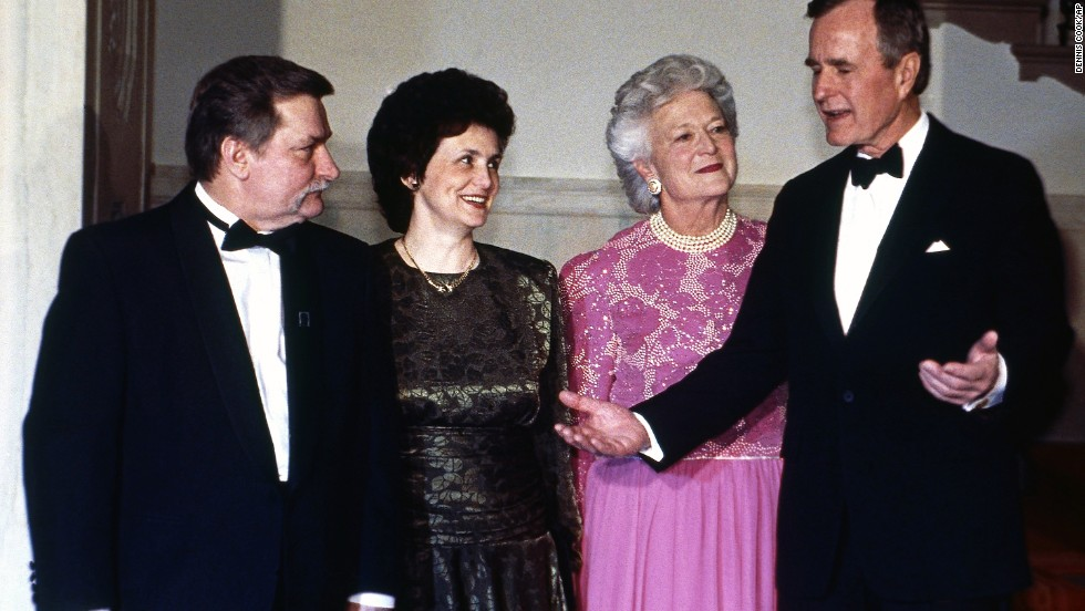 President George H.W. Bush talks with Polish President Lech Walesa and his wife, Danuta, as first lady Barbara Bush looks on before a state dinner on March 21, 1991.