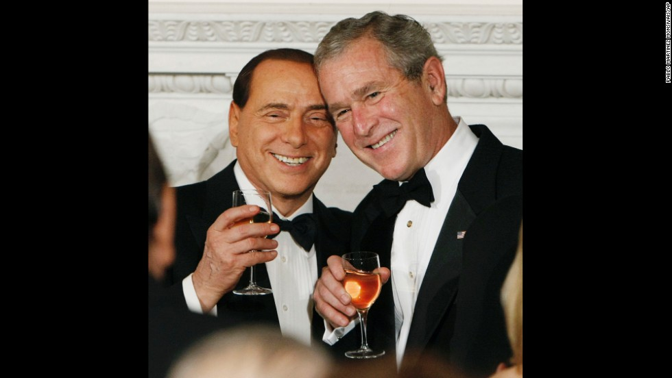 President George W. Bush toasts Italian Prime Minister Silvio Berlusconi during a state dinner on October 13, 2008.