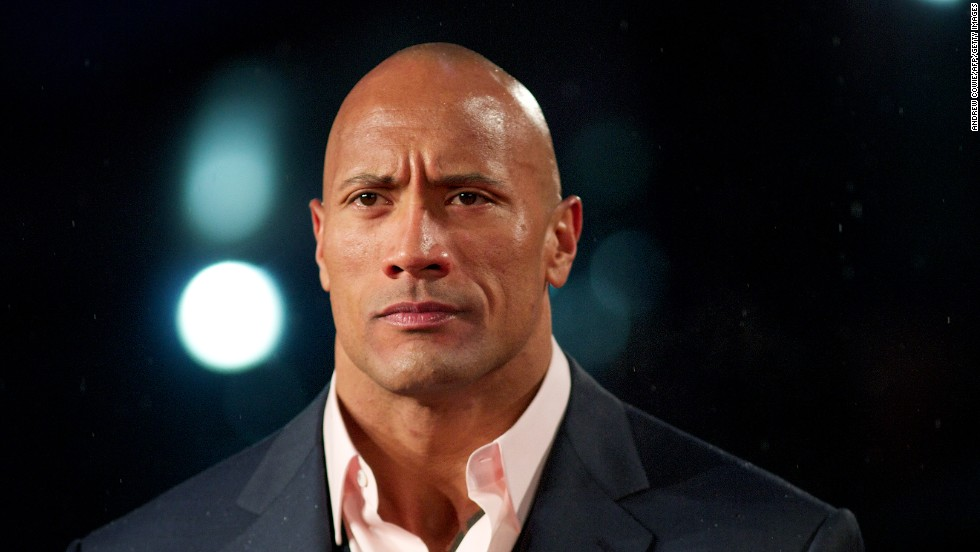 "Dwayne ""The Rock"" Johnson described himself as ""half-black and half-Samoan,"" to Vibe magazine in 1999. He is the son of wrestler Rocky Johnson and grandson to wrestler Peter Maivia, who was Samoan."