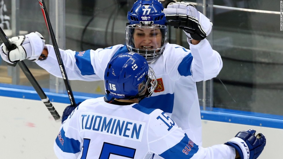 """In Finland women's ice hockey is not that popular at the moment, so this will really help to inspire people to get interested in the sport,"" says Susanna Tapani, here celebrating with teammate Minnamari Tuominen after scoring a goal against the U.S. in a preliminary round Group A game."