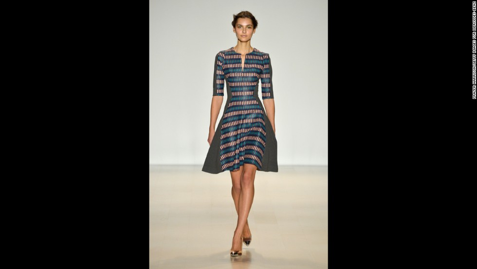 This Lela Rose dress shown during Mercedes-Benz Fashion Week Fall 2014 incorporates polished fabric and a full skirt.