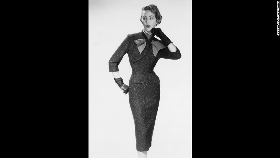The bolero-style bodice and fitted skirt on this 1950s dress emphasizes the waist of a feminine figure.