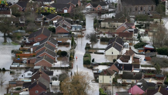 Water surrounds flooded propeties in the village of Moorland on the Somerset Levels near Bridgwater on February 10, 2014 in Somerset, England.