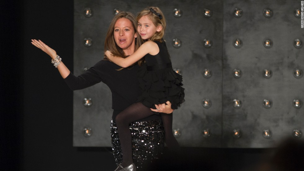 Designer Michelle Smith and her daughter came out to applause at the end of her fashion show on February 10.
