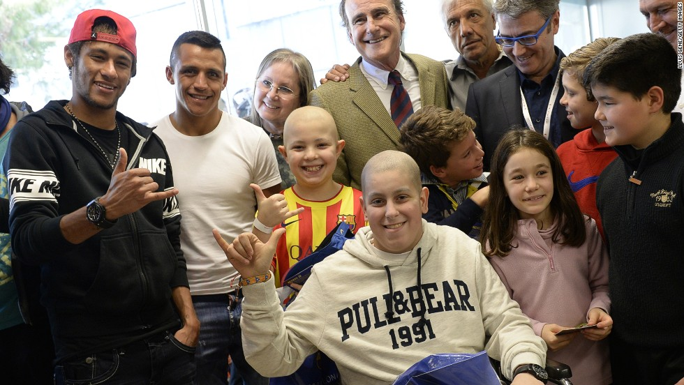 Barcelona is a club that has grown its off-field image to accompany its stunning on-field success, with the Spanish side having been crowned kings of Europe four times. Here, Neymar accompanies Alexis Sanchez during a charity visit to Barcelona's Hospital del Mar.