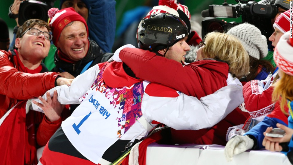 Alex Bilodeau of Canada celebrates with his family after winning the gold medal in the men's moguls on Monday, February 10.