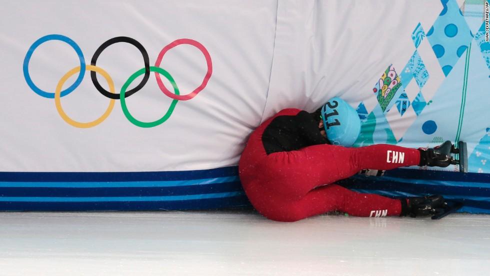 Speedskater Shi Jingnan of China crashes in a men's 1,500-meter short track race on February 10.