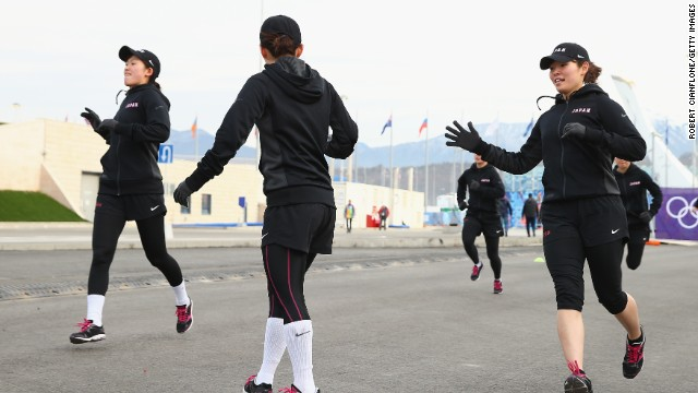 Japan's Women's ice-hockey team warms up -- literally -- in balmy conditions on Day 2 of the Sochi 2014 Winter Olympics.