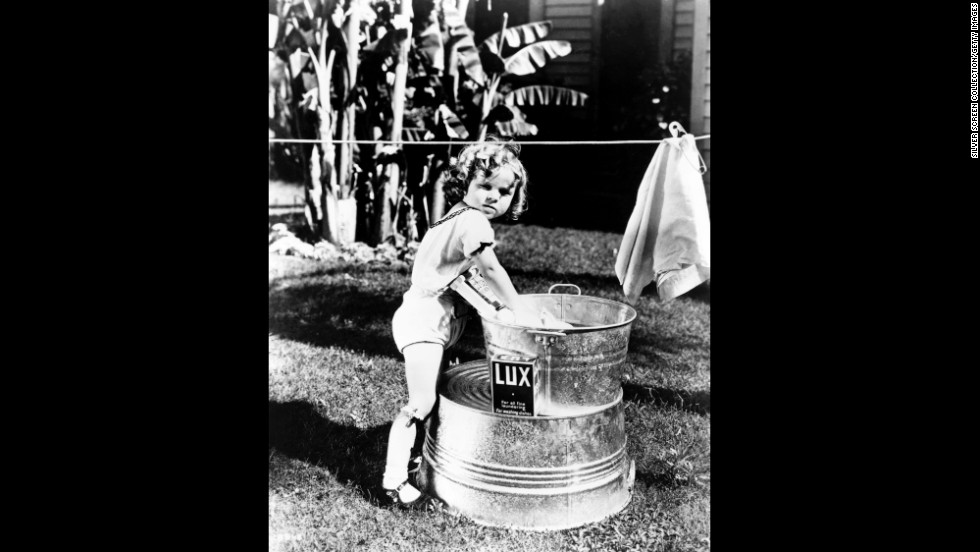 "Temple poses for a promotional photograph for one of the ""Baby Burlesks"" series of short films, circa 1932."