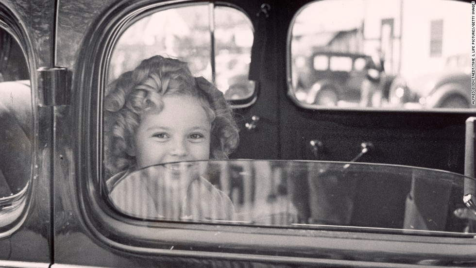 Temple arrives at the 20th Century Fox studio lot to celebrate her eighth birthday in 1936.