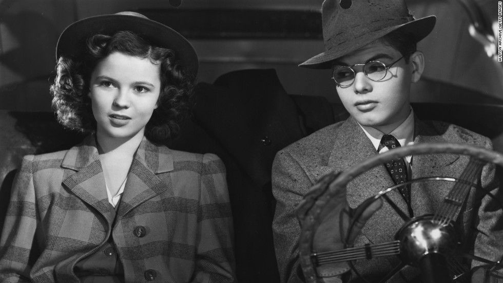 "Temple and Dickie Moore act in a scene from the film ""Miss Annie Rooney"" in 1942."