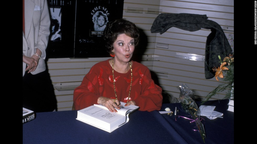 "Temple Black signs copies of her book ""Child Star"" in 1988."