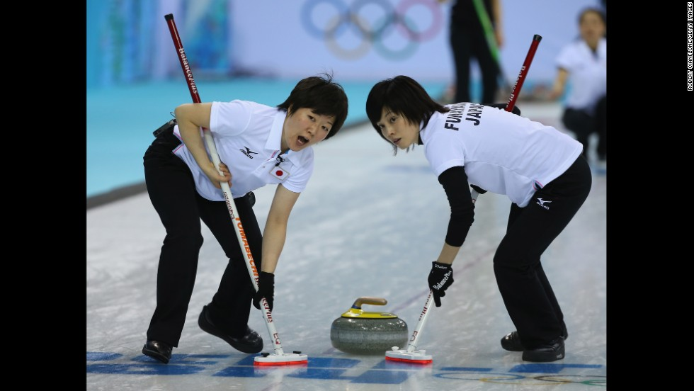 Michiko Tomabechi and Yumie Funayama of Japan sweep the ice during their curling match against South Korea on February 11.