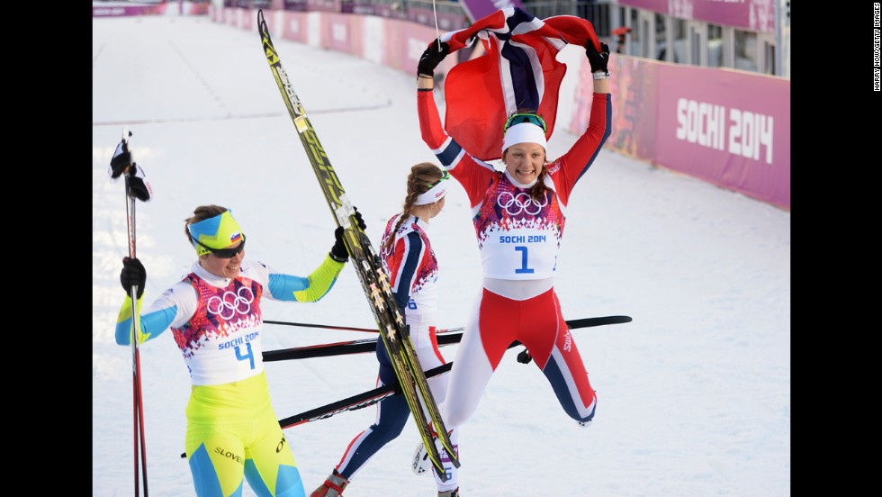 Maiken Caspersen Falla of Norway, right, and Vesna Fabjan of Slovenia celebrate February 11 after finishing in first and third place in the women's cross-country sprint.