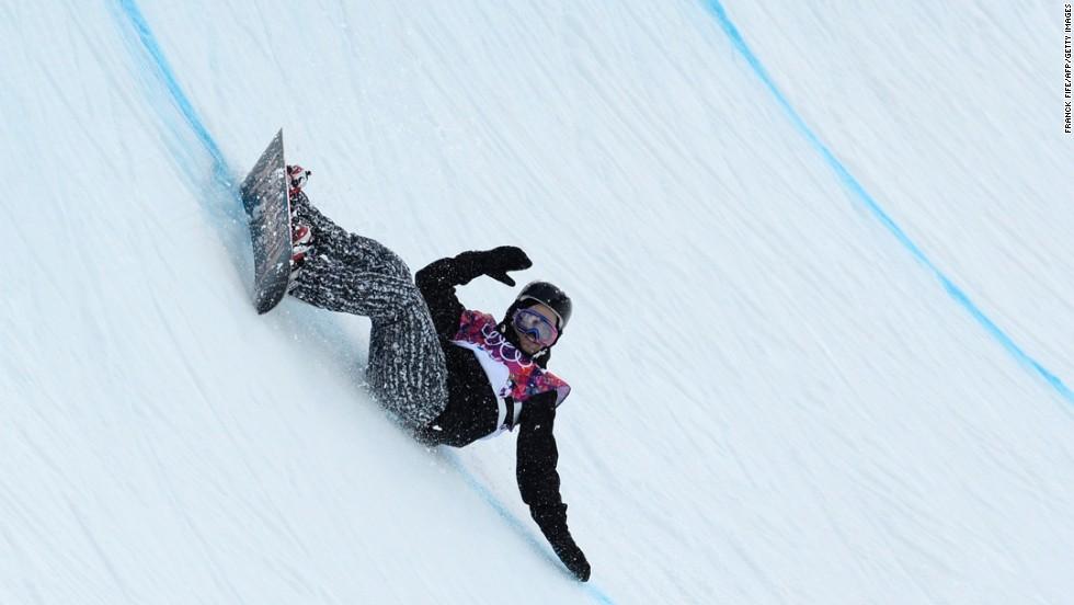 Finnish snowboarder Markus Malin falls on the halfpipe on February 11.
