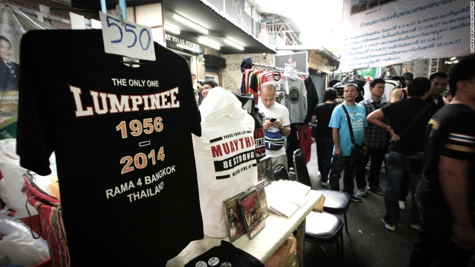 Vendors outside Lumpinee Stadium capitalized on nostalgia by selling commemorative T-shirts, priced at 550 baht ($16.75).