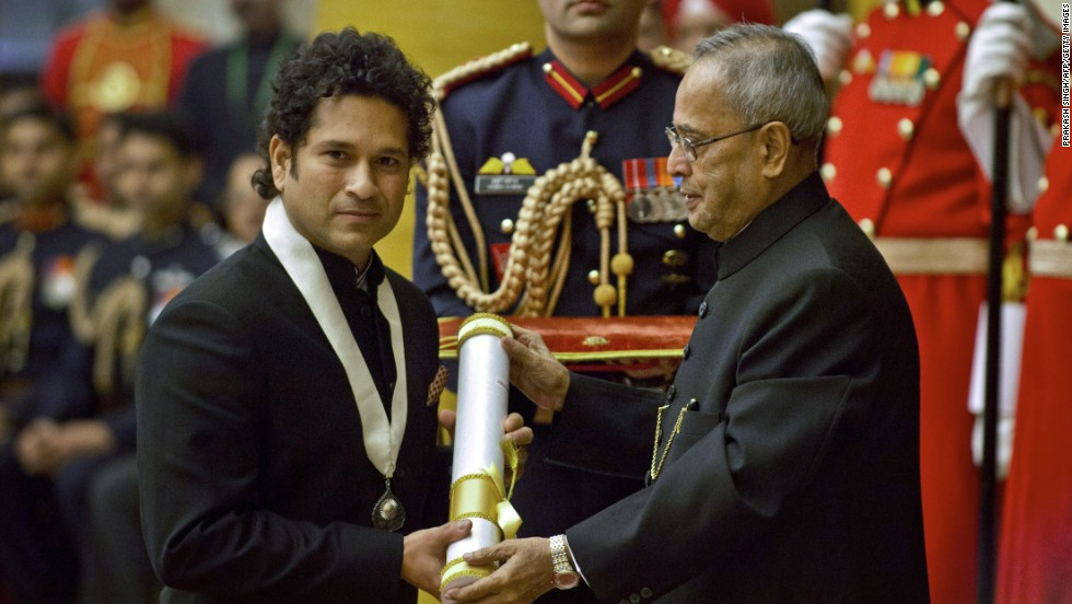 "Tendulkar received the ""Bharat Ratna"" award, India's highest civilian honor. He is pictured here during the ceremony with Indian President Pranab Mukherjee in New Delhi on February 4, 2014."