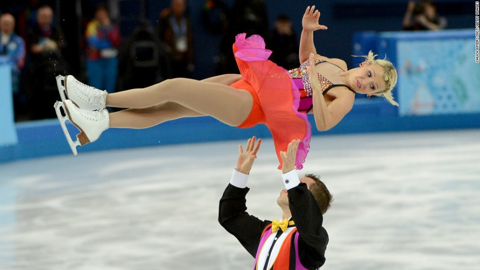 Canada's Kirsten Moore-Towers flies in the air after being thrown by Dylan Moscovitch in pairs figure skating February 11.