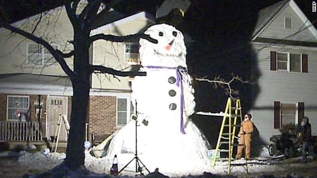 Teen builds huge snowman
