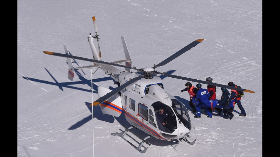 Monaco's Alexandra Coletti is taken to a helicopter after crashing during the downhill.