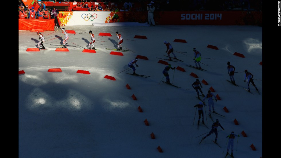 Athletes ski during the cross-country portion of the men's Nordic combined on February 12.