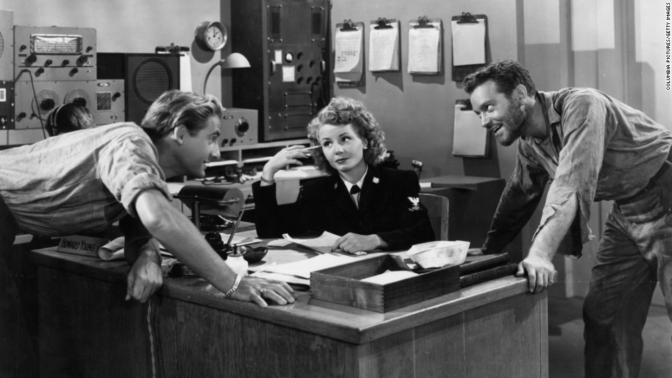 "Caesar leans on table in front of Janet Blair and Alfred Drake in a scene from the 1946 film ""Tars and Spars."""