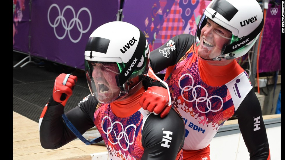 Austria's Andreas Linger, left, and Wolfgang Linger celebrate after their luge run on February 12. They won silver.
