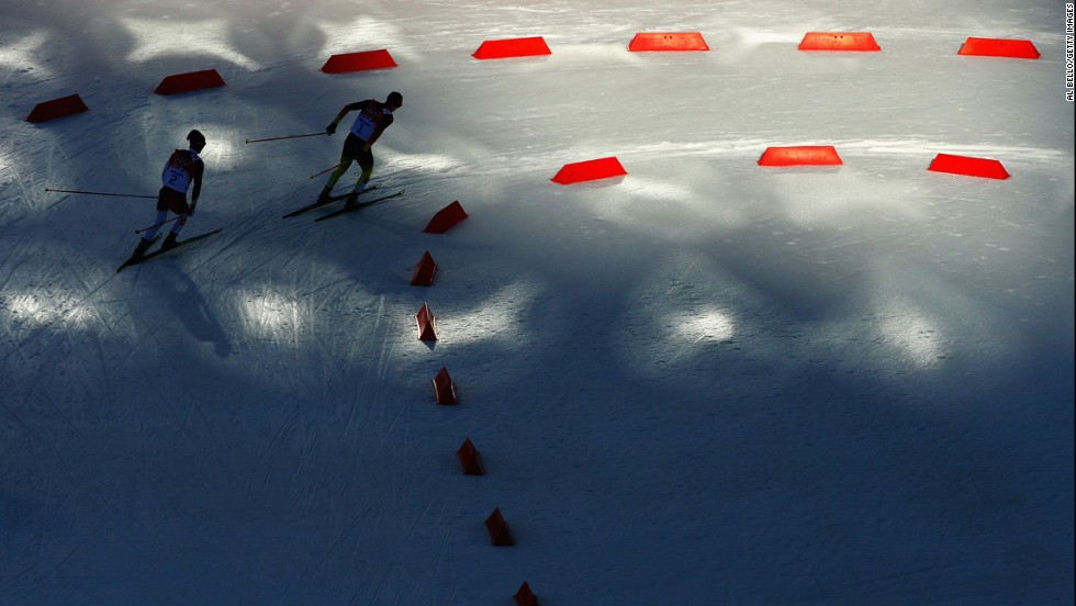 Eric Frenzel of Germany, right, and Akito Watabe of Japan compete February 12 in the cross-country skiing portion of the normal hill Nordic combined event. Frenzel won gold.