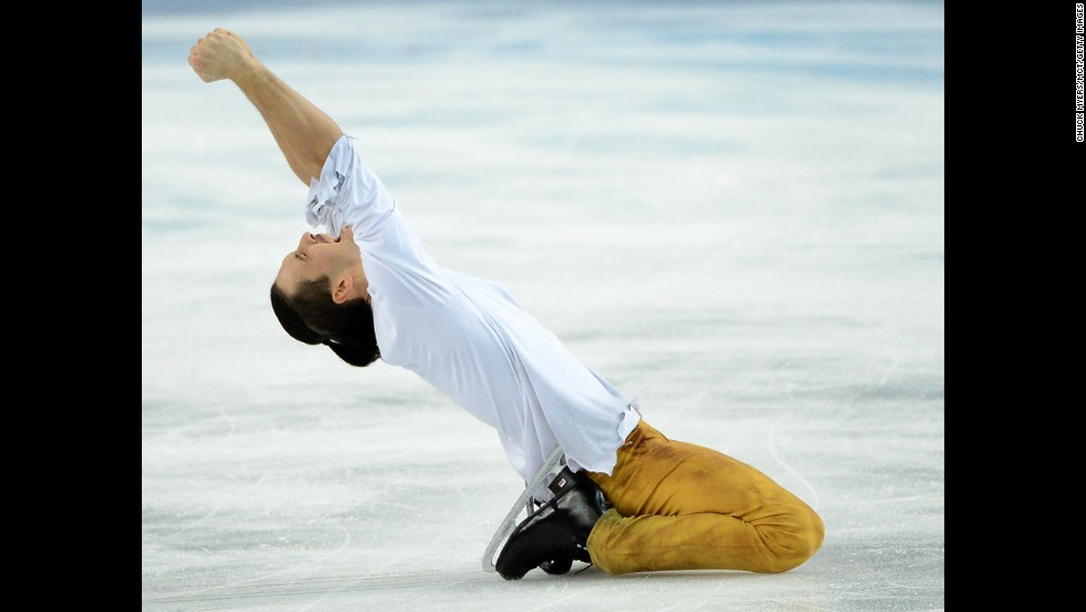 Maxim Trankov of Russia celebrates a gold-medal performance in pairs figure skating.