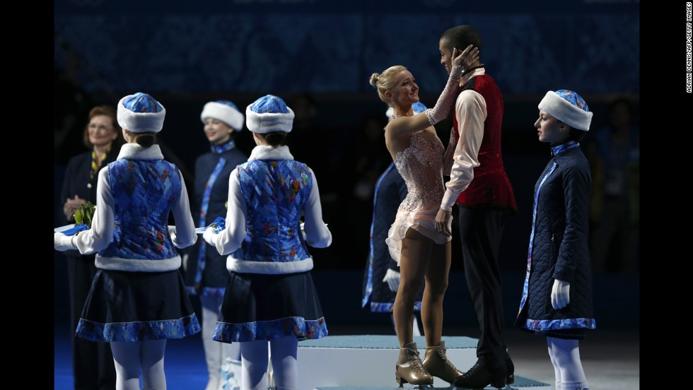 Germany's Aliona Savchenko and Robin Szolkowy receive the bronze medal for pairs figure skating on February 12.