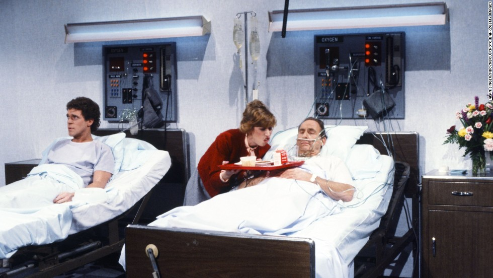 "Caesar plays a patient during the ""Whiners"" skit on a 1983 episode of ""Saturday Night Live."" Joe Piscopo, left, and Robin Duke play the parts of Doug and Wendy Whiner."