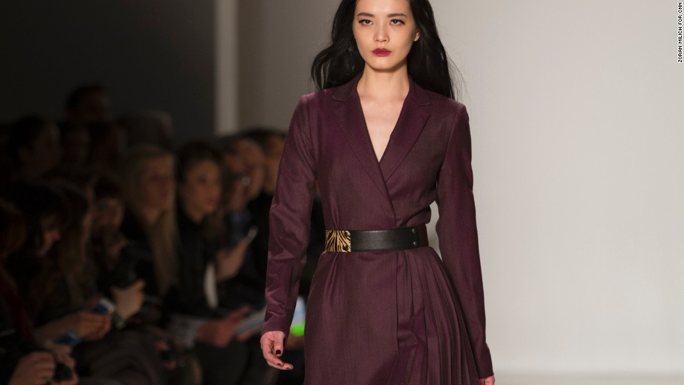 Nanette Lepore kept maroon suiting feminine with a tiger print belt.